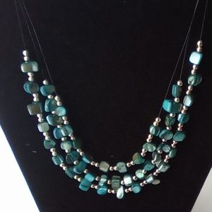 Beautiful 3 stranded Pearl Chip Beaded Necklace.